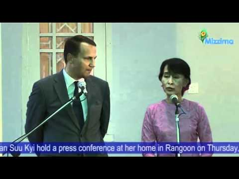 Poland's FM Radoslaw Sikorski and Daw Aung San Suu Kyi hold a press conference