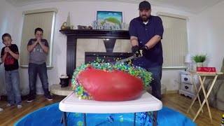 1000 Degree Sword Vs GIANT ORBEEZ BALLOON and Gummy Big Mac Cheeseburger!!