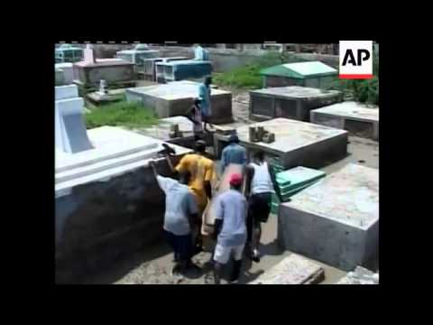 Residents in Haiti have started to bury some of those who died during Hurricane Ike.  This as foreig