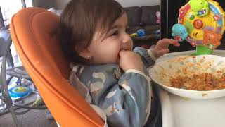 Baby girl eating Pasta