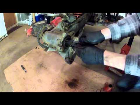 400ex rear axle bearing carrier removal