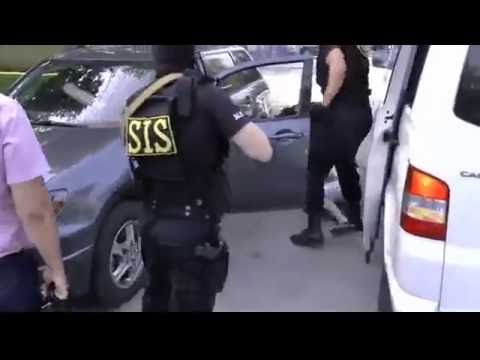Moldova uranium smuggling  Armed officers arrest suspects Dramatic video of moment security officia