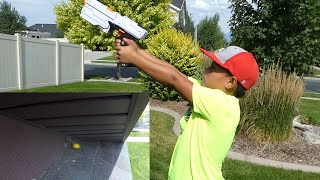 SHOOTING A WASP NEST WITH A NERF GUN!!