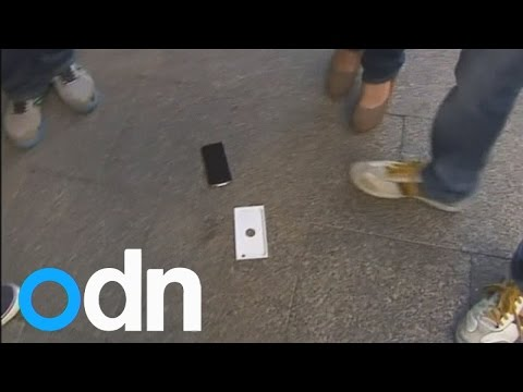 Watch the moment Australian man drops iPhone 6 after queuing all night