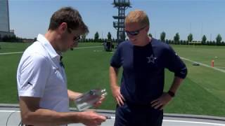 Indy 500 winner Will Power signs milk bottles for the Dallas Cowboys