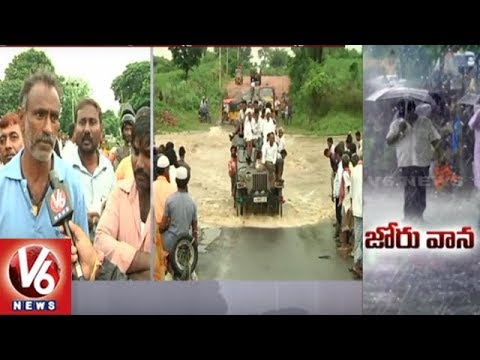 Heavy Downpour In Adilabad District | People Face Problems As Low Level Bridges Brimming | V6 News