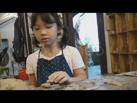Asian Kid Shaping Pottery. Stock Footage
