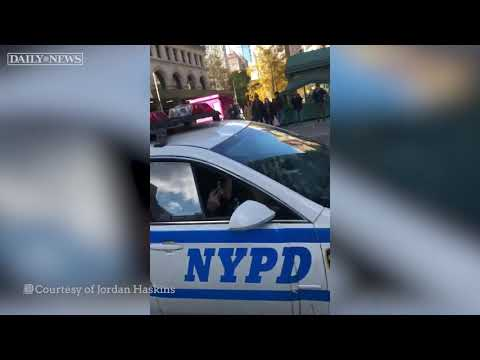 NYPD officer sings along to Backstreet Boys in the East Village