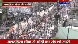 Narendra Modi begins roadshow in Varanasi; huge crowd present