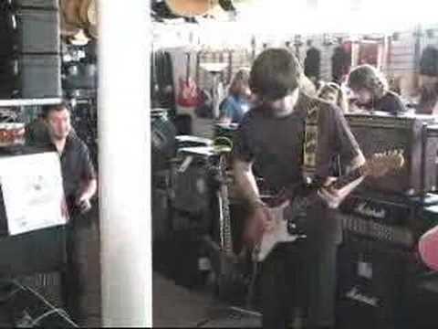 Jeff Carlisi watches Josh of finishline guitar solo contest