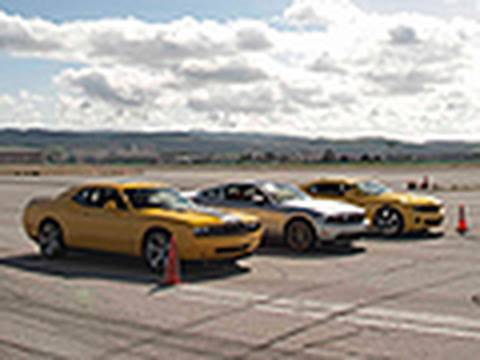 The new 2011 Ford Mustang GT battles its bitter V-8 rivals --the Chevrolet Camaro SS and the Dodge Challeneger SRT8 -- in an epic quarter-mile drag race. Sho...