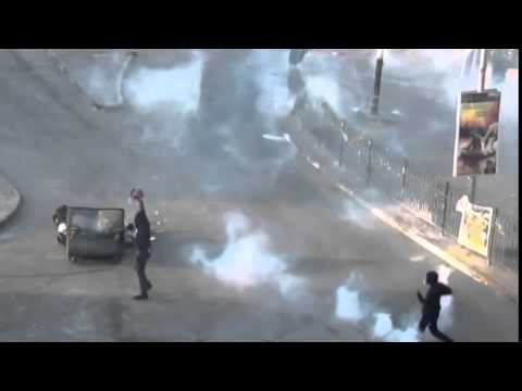 Bahrain regime forces shoot protesters with tear gas. Riots