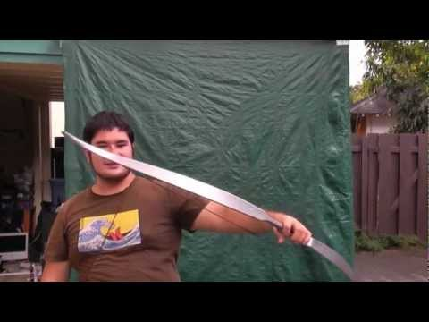 Shooting the Hunger Games Capitol Silver Recurve Bow - PSE Snake