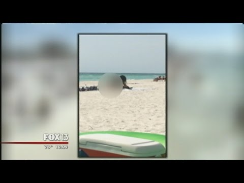 Caught on video: Couple arrested after sex on the beach police...