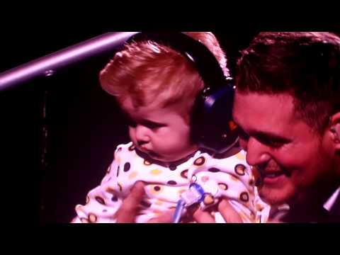 Michael Buble' picks up Noah his son during show