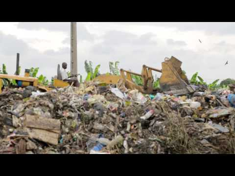 Cleaning the trash dump in Abobo, Abidjan, Cote d'Ivoire