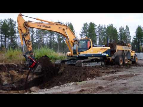 Hyundai R 290 LC-9 with Indexator ® Rototilt loading Volvo A25C