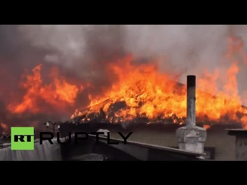 Ukraine: Houses catch fire after shelling near Donetsk airport