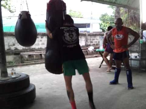 Clinch Knees on Bag - Lanna Muay Thai Image 1