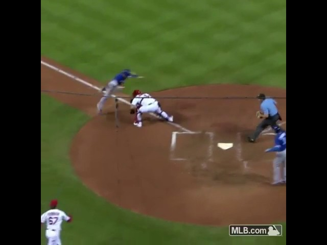 Blue Jays Chris Coghlan jumps over catcher Yadier Molina and scores! Blue Jays player jumps over