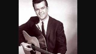 Watch Conway Twitty The Big Man Above video