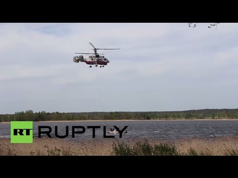 Russia: EMERCOM lifts crashed helicopter out of lake in Olkhovka after 2 killed