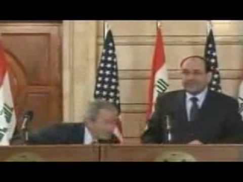 UNCENSORED FOOTAGE of shoes and insults hurled at Bush on Iraq visit