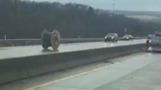 Runaway giant wire spool rolls down Pennsylvania highway