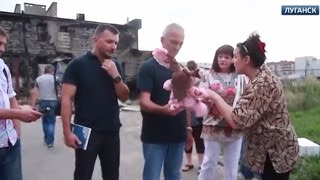 A toy covered with the blood of a child for Poroshenko. OSCE inspecting Lugansk [Eng Subs]