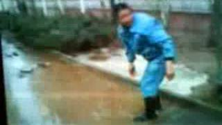 Chinese Biker Gets Owned by Massive Puddle