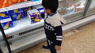 Funny Baby doing shopping in supermarket