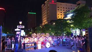 She is walking the streets of Nguyen Hue. Watch Anh Trong Nhan hit the drums.