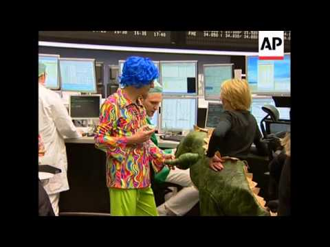 Frankfurt stock market falls, traders in fancy dress for carnival