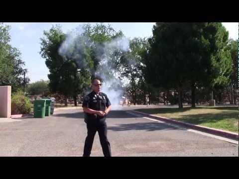 APD SWAT Officer Throws Flash Bang Grenade