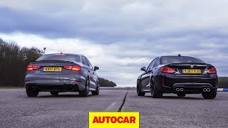Drag race: Audi RS3 vs BMW M2, rolling race | What's the fastest £50k compact car? | Autocar