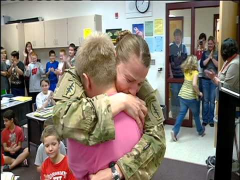 Soldier returns from deployment and surprises her son and daughter at school