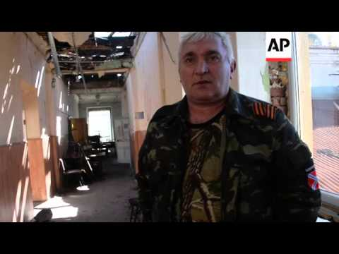 Captured Ukrainians help in clean-up in rebel-held city of Donetsk after months of shelling