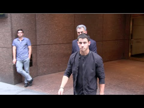 (New) (Exclusive) Nick Jonas leaving a Office Building in NYC 07-23-14