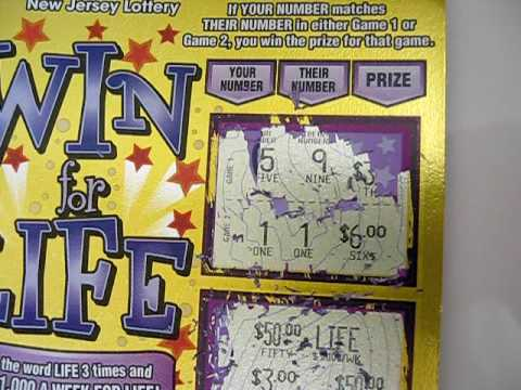 Scratching off a nj win for life instant lottery ticket