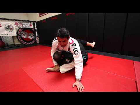 Jiu Jitsu Techniques - Omoplata Sweep To Mount / Triangle Image 1