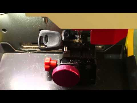SEC E9 Automatic Key Cutting Machine --- How to Cut a Jaguar FO21 Tibbe Key