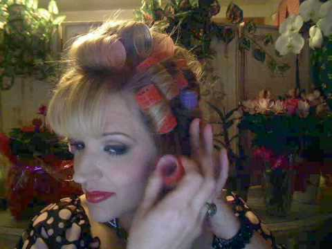 velcro rollers hairstyles. Notice the red velcro rollers