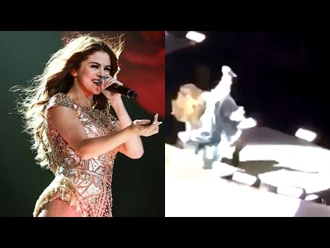 Selena Gomez Falls on Stage During Concert