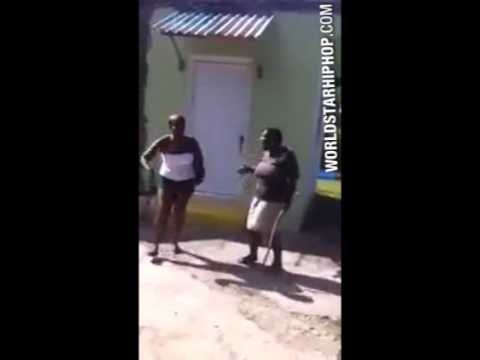 Video  Jamaican Granny Beats Young Girl With A Stick For Messing With Her Man!