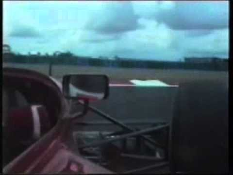 jean alesi taps the rear wheel of johnny herberts benetton and causes him to retire.