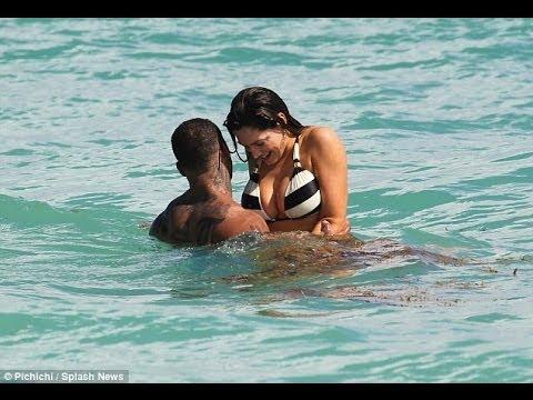 Kelly Brook in the sea in black and white striped bikini with boyfriend David McIntosh