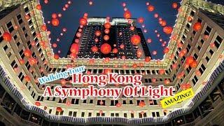 Walking Tour Hong Kong Famous lights show 'A Symphony of Lights'  in Tsim Sha Tsui at Night