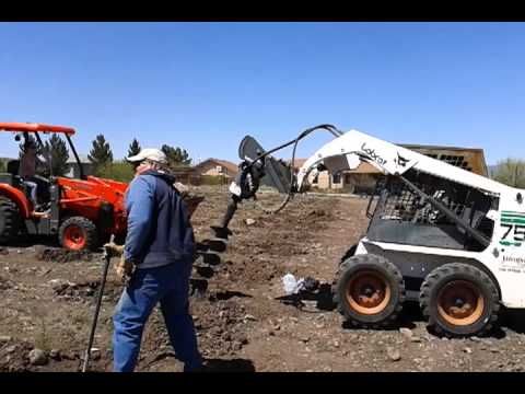 Moving rocks and augering holes for end posts, 04-20-2013, Yavapai College student vineyard