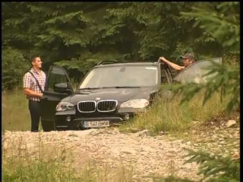 Gerard Butler & Madalina Ghenea with BMW X5