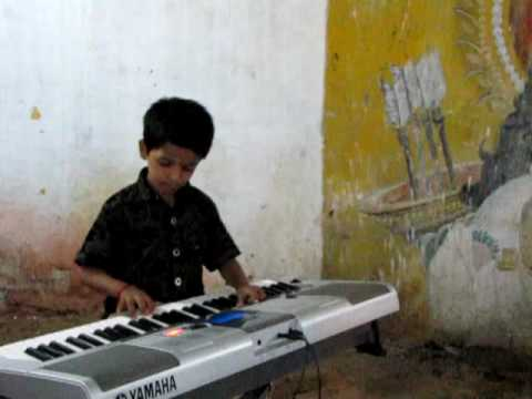 Padmesh Playing Nenjukkul Song From Movie Varanam Ayiram video